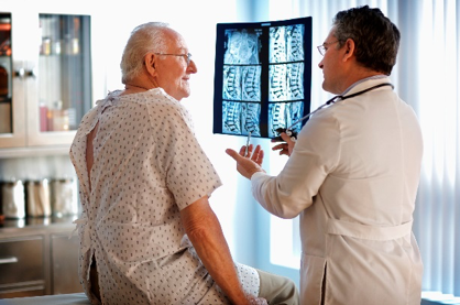 Doctor reviewing patient x-rays.
